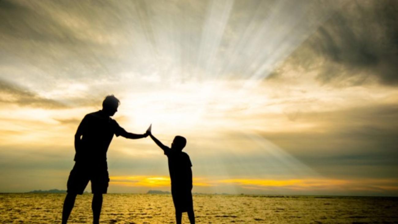 father_son_beach-580x397